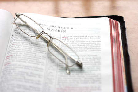 In the photo Open Bible with glasses photo