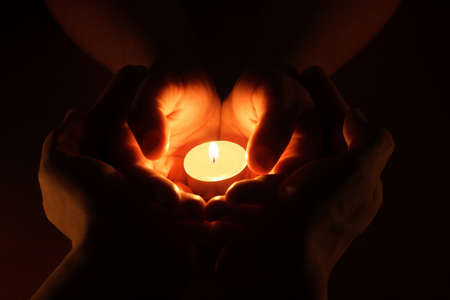 Candle in hand. The concept of protection photo