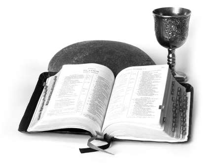 covenant: Open Bible with bread and wine