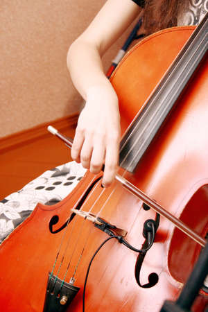 A young girl playing the cello photo