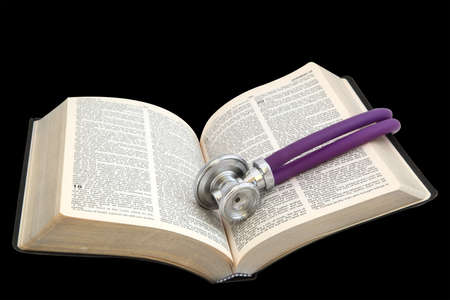 The Bible and the stethoscope on white background Stock Photo