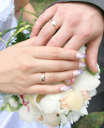 Hands newlyweds at the wedding bouquet Stock Photo - 13143406