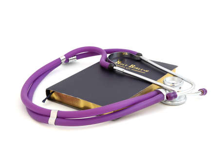 stethoscope on the Bible. Isolated on white background Stock Photo - 13896098