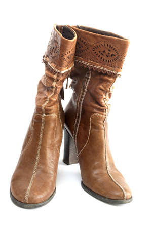 Womens brown boots on a white background photo
