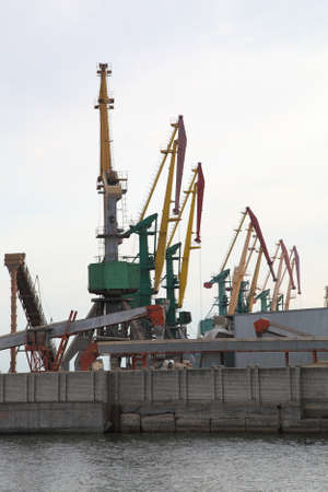tonnage: Cranes at the dock. Kherson. Ukraine. The Dnieper River