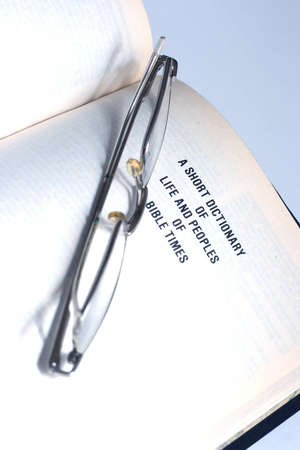 Open Bible with glasses Stock Photo - 15542719