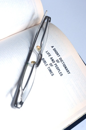 Open Bible with glasses photo