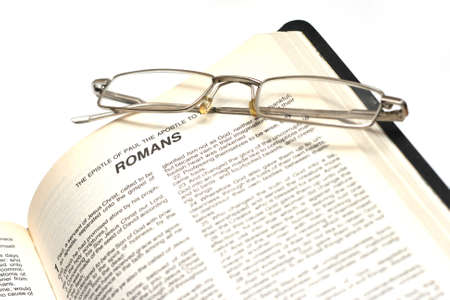 Open Bible with glasses Stock Photo
