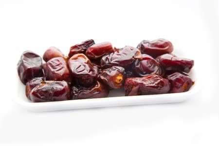 deglet: Dried fruits. Dates isolated on white background Stock Photo