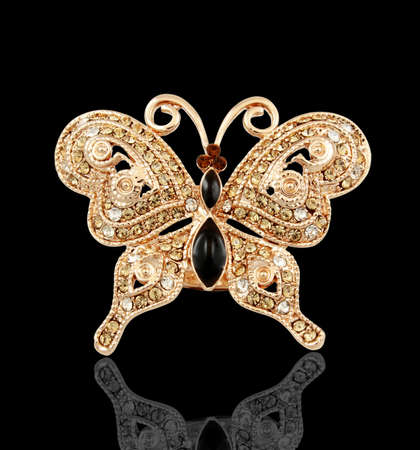 nicety: golden butterfly isolated on black isolated Stock Photo
