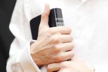 Men with Holy Bible Stock Photo