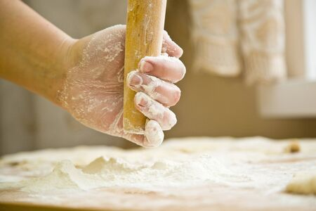 hand with rolling pin and flour photo
