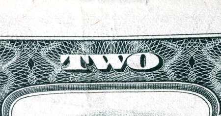 two dollar bill: part two dollar bills. The word two close-up Stock Photo