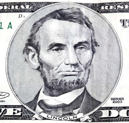 five dollar bill: Portrait of Abraham Lincoln in front of the five dollar bill