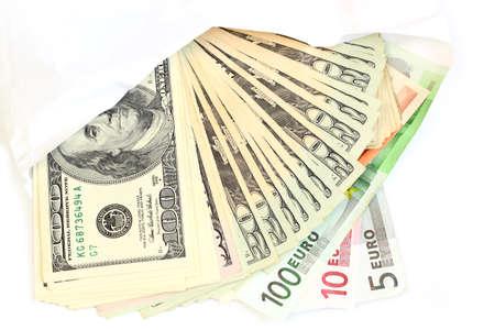 money in envelope isolated on white photo