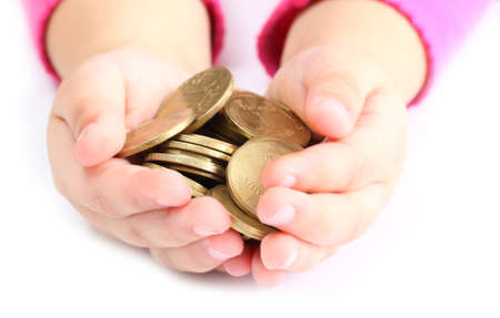 in the hands of a child holding a coin photo