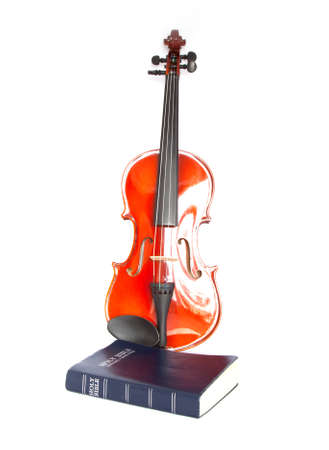 violin with holy Bible isolated on white Stock Photo - 19378569