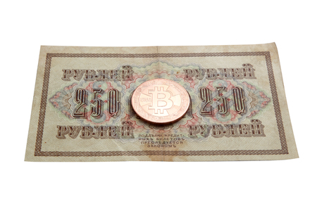 on the photo 250 ancient Russian rubles and on them a bitcoin coin. It will become new in the financial system Stockfoto