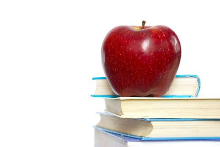 Red apple and stack of books  photo