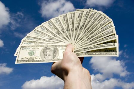 Money in hand  isolated on sky background Stock Photo - 3013654