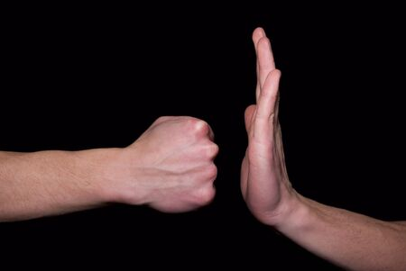 handshakes: stroke  by a fist in a hand  Stock Photo