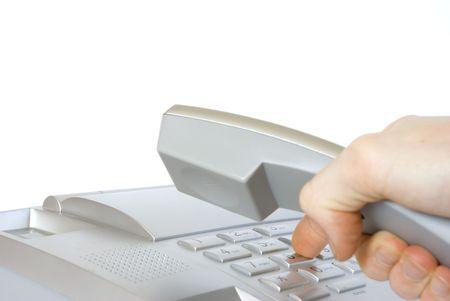 operating key: Finger presses figure on phone  Stock Photo
