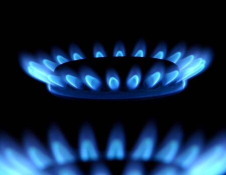 Blue flames of gas stove in the dark                                Stock Photo - 3052424
