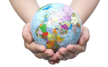 whiteness: Hands holdings a globe on a whiteness Stock Photo