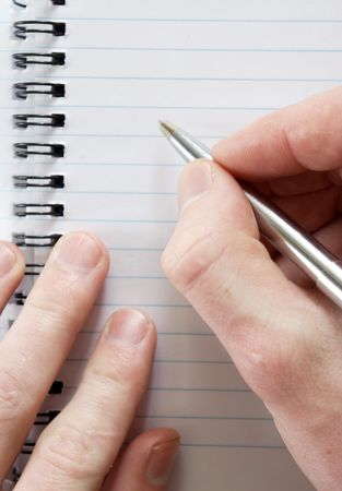 male hand with pen ready for writing photo
