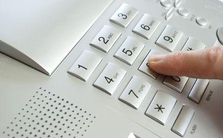 finger with grey telephone keypad photo