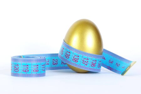 priceless: gold egg with measuring tape  around Stock Photo