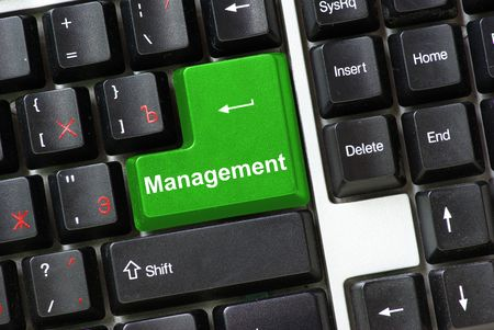 The keyboard with green button of management photo