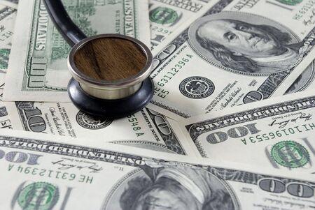 Stethoscope on money background of  dollars Stock Photo - 3338306