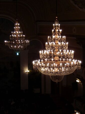 Two chandeliers are in an assembly hall                                photo