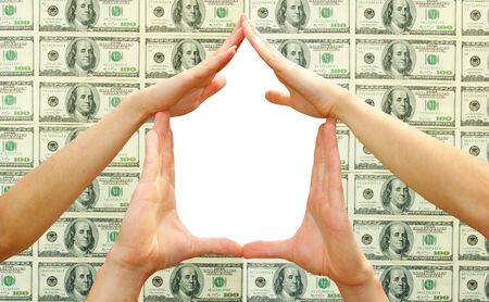 House made of  woman hands isolated on dollars   photo