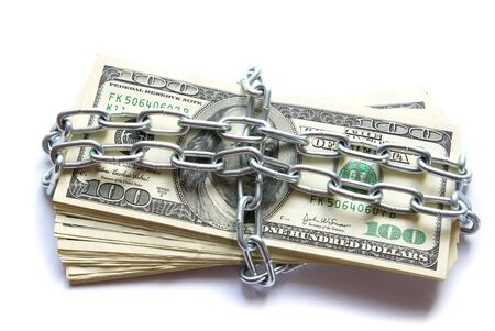 Dollars locked a chain on a white background photo