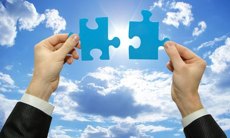 puzzle in hand isolated on sky background Stock Photo