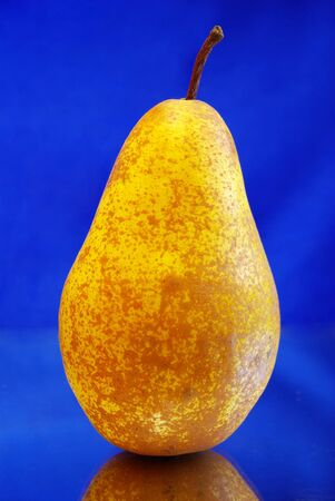 yellow pear isolated over blue Stock Photo - 3951495