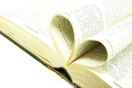 The opened bible is isolated on a white background Stock Photo