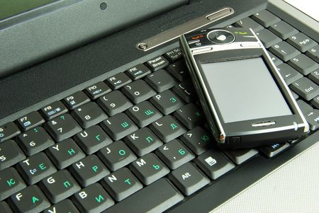 communicator: mobile isolated on a laptop