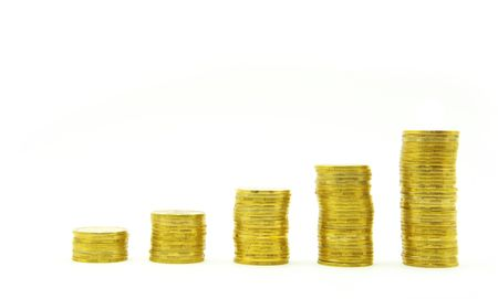 whiteness: three towers of coins isolated on a whiteness Stock Photo