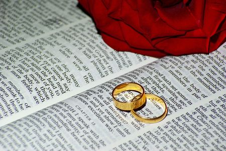 Wedding ring over a Bible photo