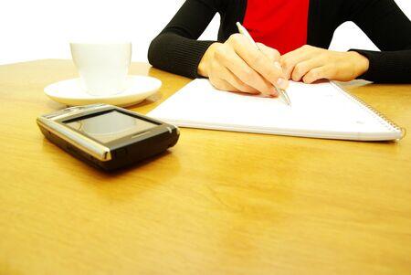businesswoman writes a pen on an empty paper photo