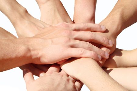 hands clasped: hands of my friends on white                                Stock Photo