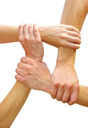 linked together: Linked hands on a white background symbolizing teamwork and friendship Stock Photo