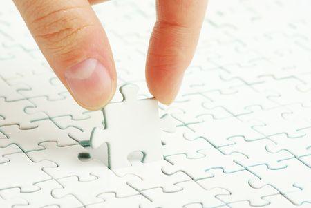 hands holding a puzzle piece . business concepts photo
