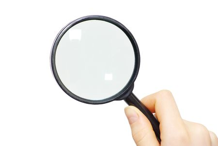 hand holding a magnifying glass on white photo