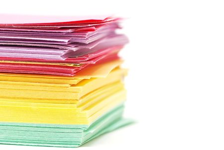 batch: Batch of assorted color paper over white background Stock Photo
