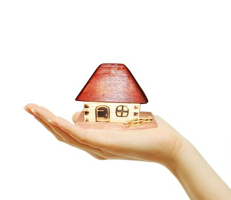 house in human hands on white Stock Photo - 6480045