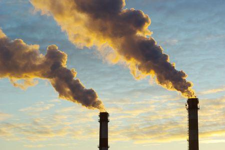 Power plant with smoke under sky photo